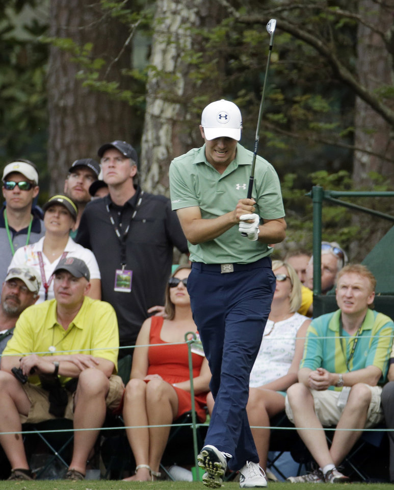 Photo - Jordan Spieth reacts to his tee shot on the 16th hole during the fourth round of the Masters golf tournament Sunday, April 13, 2014, in Augusta, Ga. (AP Photo/Charlie Riedel)