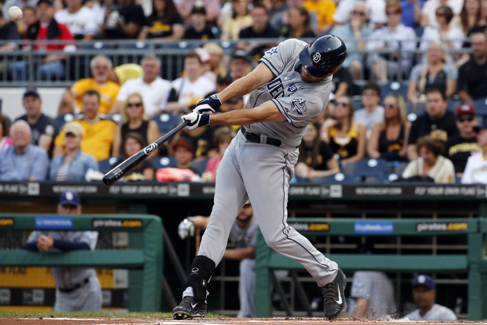 Photo - San Diego Padres' Seth Smith drives in a run with a sacrifice fly to left field off Pittsburgh Pirates starting pitcher Vance Worley during the first inning of a baseball game in Pittsburgh, Friday, Aug. 8, 2014. (AP Photo/Gene J. Puskar)
