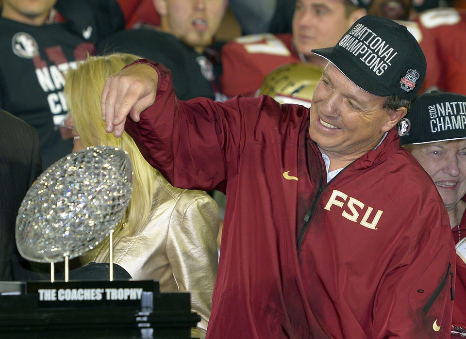 Photo - Florida State head coach Jimbo Fisher with The Coaches' Trophy after the NCAA BCS National Championship college football game against Auburn Monday, Jan. 6, 2014, in Pasadena, Calif. Florida State won 34-31. (AP Photo/Mark J. Terrill)