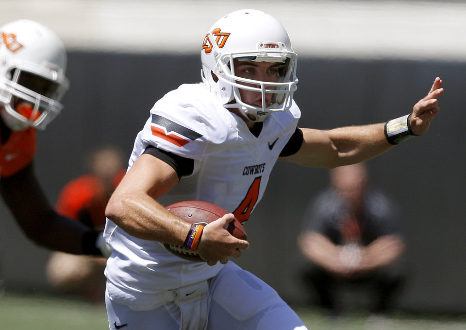 Photo - OSU's J.W. Walsh scrambles during Oklahoma State's spring football game at Boone Pickens Stadium in Stillwater, Okla., Saturday, April 21, 2012. Photo by Bryan Terry, The Oklahoman