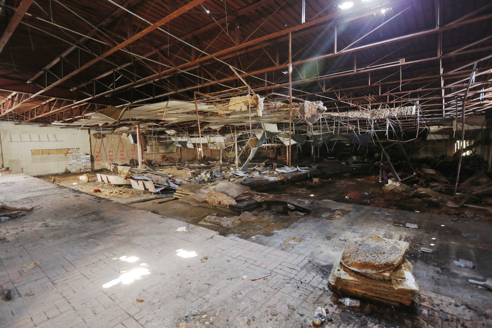 Photo -  Although some flooring remains, everything else of value has been stripped from the Bryant Center, one of numerous abandoned properties in northeast Oklahoma City. [Photo by Paul Hellstern, The Oklahoman]