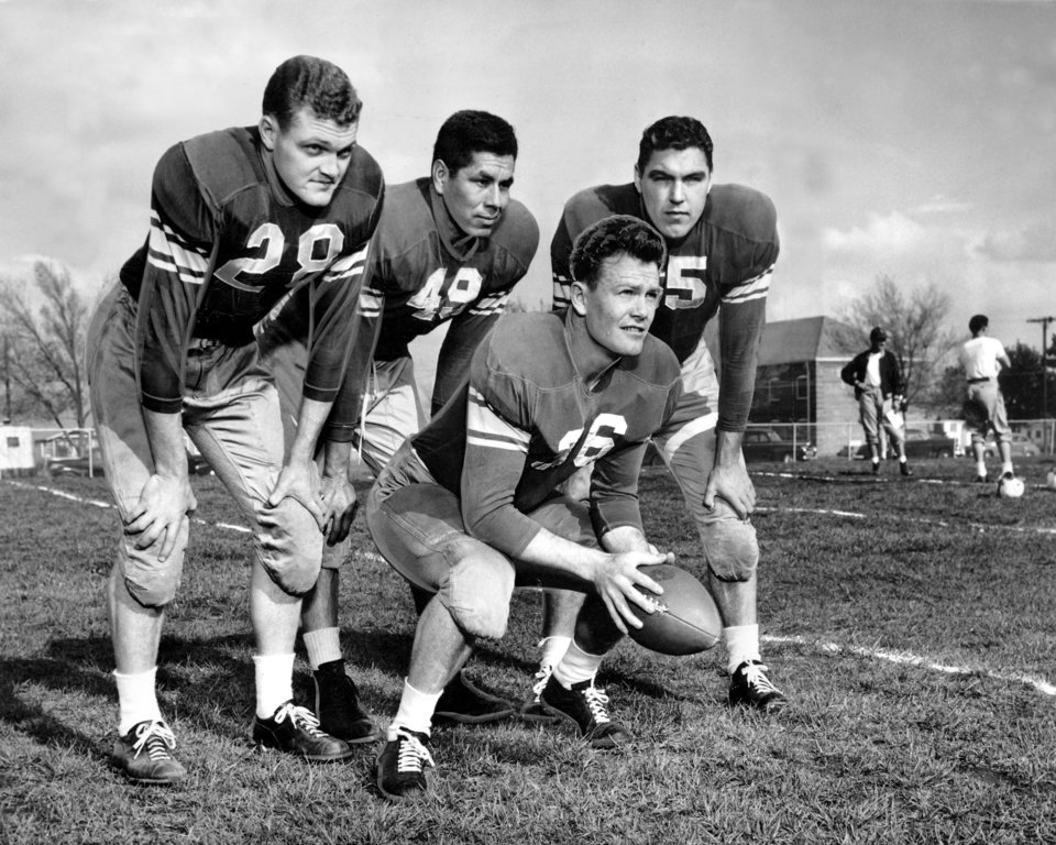 Photo - Darrell Royal, with ball, lines up with the Alumni backfield that battled Bud Wilkinson's University of Oklahoma varsity squad in 1950 at Taft Stadium. Behind Royal, left to right, are George Thomas, lefthalf, Jack Jacobs, fullback, and Lindell Pearson, righthalf.  OKLAHOMAN ARCHIVE PHOTO