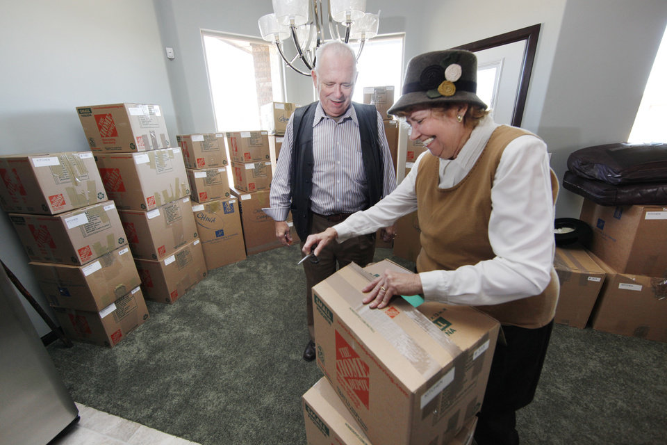 Richard and Marlene Deatherage unpack at their new home in northwest Oklahoma City, west of Edmond. The retirees just moved from a Detroit suburb. Photo by Steve Gooch, The Oklahoman