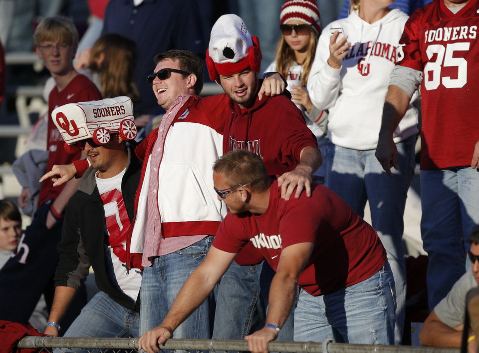 Photo - Oklahoma fans celebrate during the college football game between the University of Oklahoma Sooners (OU) and the University of Kansas Jayhawks (KU) at Memorial Stadium in Lawrence, Kan., Saturday, Oct. 19, 2013. Oklahoma won 34-19. Photo by Bryan Terry, The Oklahoman