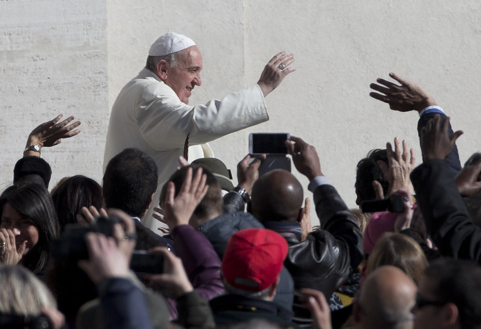 Photo - Pope Francis greets the crowd as he arrives for his weekly general audience in St. Peter's Square at the Vatican, Wednesday, March 5, 2014. The pontiff  says he finds the hype that is increasingly surrounding him