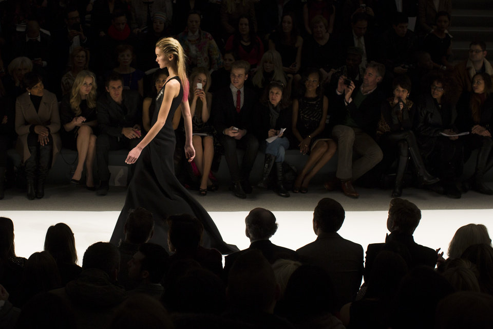 Photo - A model walks the runway at the presentation of the Carmen Marc Valvo Fall 2013 fashion collection during Fashion Week, Thursday, Feb. 7, 2013, in New York. (AP Photo/John Minchillo)