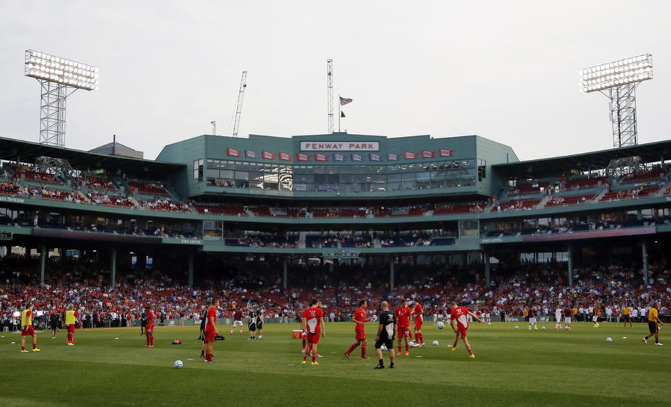 Photo - Liverpool FC players warm up prior to a friendly soccer match against AS Roma at Fenway Park in Boston, Wednesday, July 23, 2014. (AP Photo)