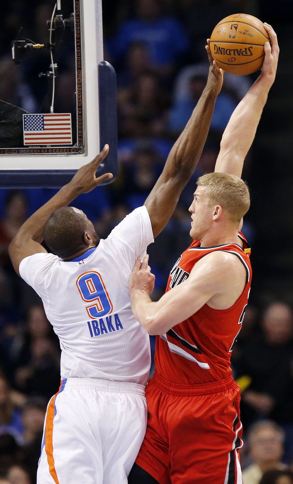 Photo - Oklahoma City's Serge Ibaka (9) blocks a shot by Portland's Mason Plumlee (24) during an NBA basketball game between the Oklahoma City Thunder and the Portland Trailblazers at the Chesapeake Energy Arena in Oklahoma City, Monday, March 14, 2016. Photo by Nate Billings, The Oklahoman