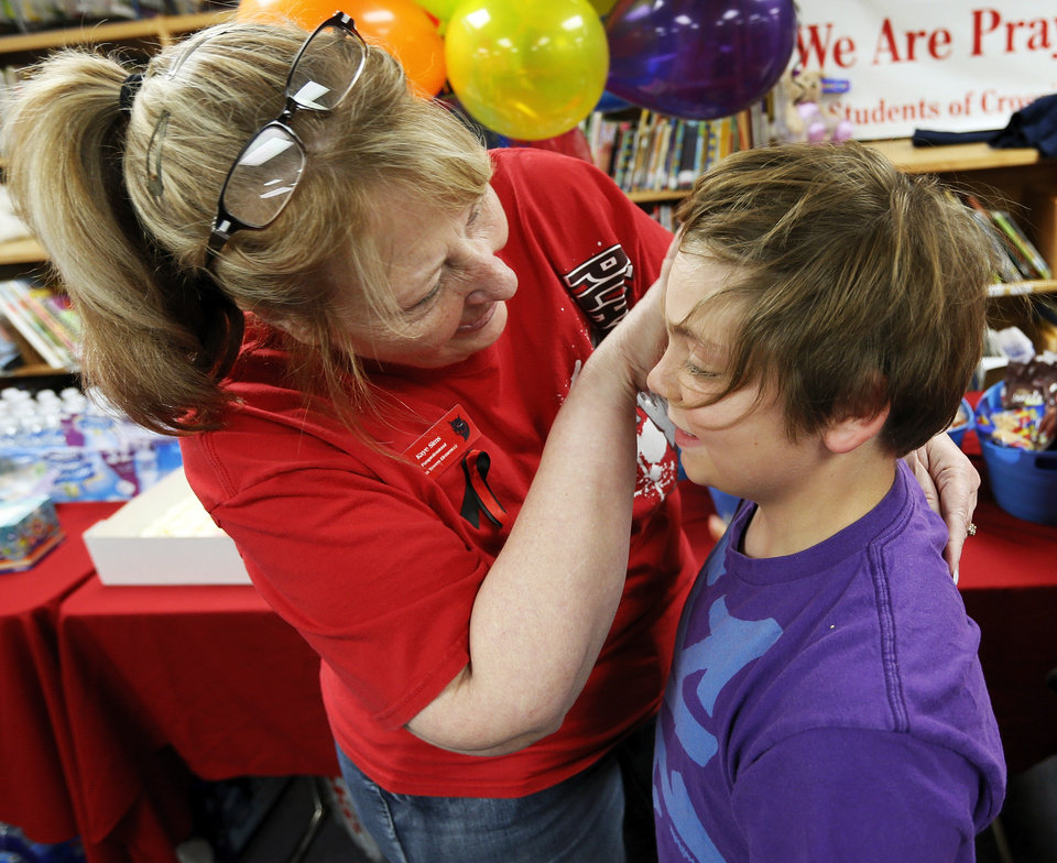 Plaza Towers paraprofessional Kaye Sims brushes the hair out of the eyes of 3rd-grader Cort Nayphe, 9, during a meet and greet with teachers and students from Plaza Towers Elementary at Eastlake Elementary School in Oklahoma City, Thursday, May 23, 2013. Seven Plaza Towers students died when a tornado destroyed the school in Moore, Okla., on Monday. Photo by Nate Billings, The Oklahoman