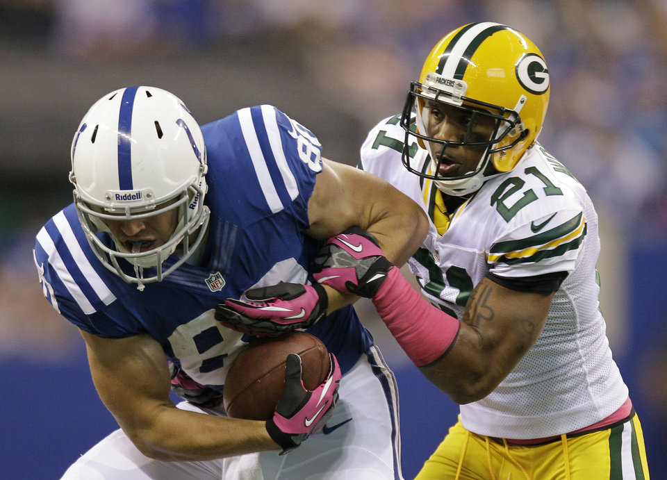 Photo -   Indianapolis Colts tight end Coby Fleener (80) is tackled by Green Bay Packers strong safety Charles Woodson (21) during the first half of an NFL football game in Indianapolis, Sunday, Oct. 7, 2012. (AP Photo/Michael Conroy)