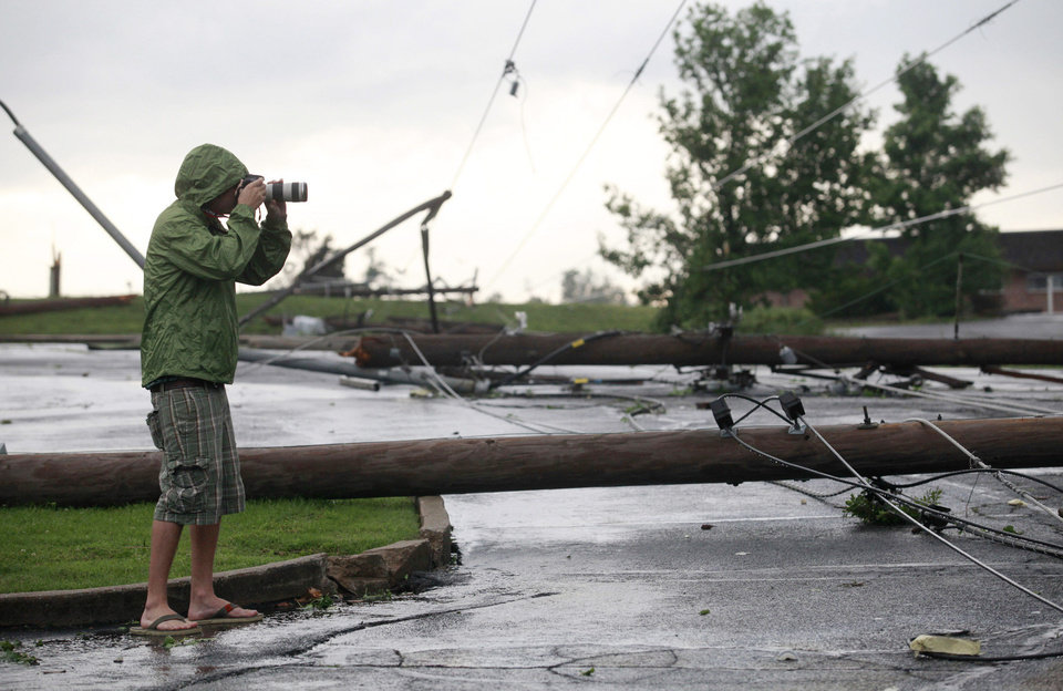Photo - A photographer shoots some of the damage near St. Joseph Hospital in Joplin, Mo., after the town was hit by a tornado on Sunday, May 22, 2011. (AP Photo/The Wichita Eagle, Jaime Green) ORG XMIT: KSWIE105