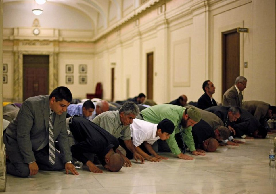 Photo -  A group prays during the Capitol Interfaith Iftar at the state Capitol in Oklahoma City, Wednesday, August 17, 2011. Photo by Bryan Terry, The Oklahoman ORG XMIT: KOD