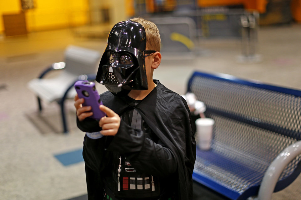 Landon Hood, 9, of Dale, looks at photos of himself on a phone during the Science Museum Oklahoma's  Bright Night of Star Wars sleepover. Photo by Bryan Terry, The Oklahoman <strong>Bryan Terry - THE OKLAHOMAN</strong>