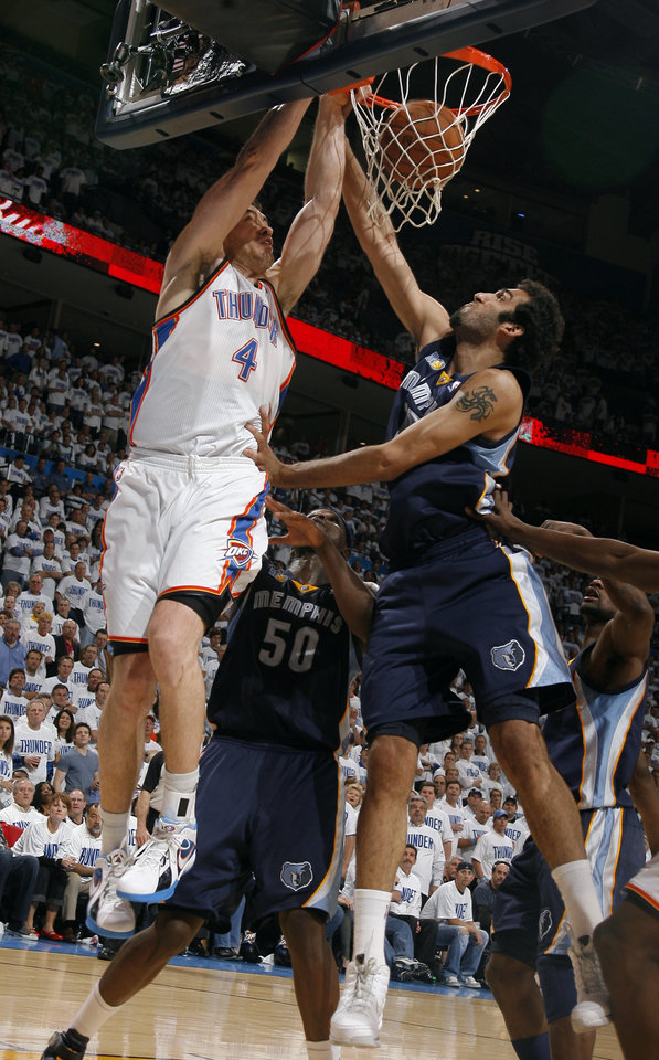 Oklahoma City's Nick Collison (4) dunks over Hamed Haddadi (15) of Memphis during game five of the Western Conference semifinals between the Memphis Grizzlies and the Oklahoma City Thunder in the NBA basketball playoffs at Oklahoma City Arena in Oklahoma City, Wednesday, May 11, 2011. Photo by Sarah Phipps, The Oklahoman