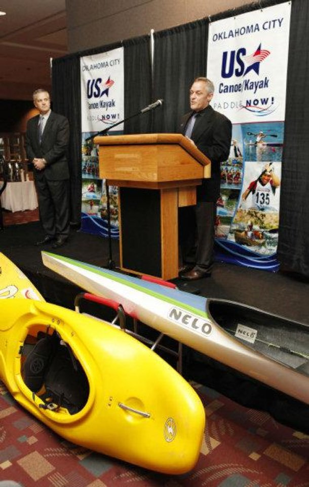 Photo - Bob Lally, USA Canoe/Kayak board chairman, looks on as Joe Jacobi, USA Canoe/Kayak CEO, speaks during a ceremony Tuesday announcing the relocation of the headquarters for USA Canoe/Kayak to Oklahoma City. Photo by Paul B. Southerland, The Oklahoman