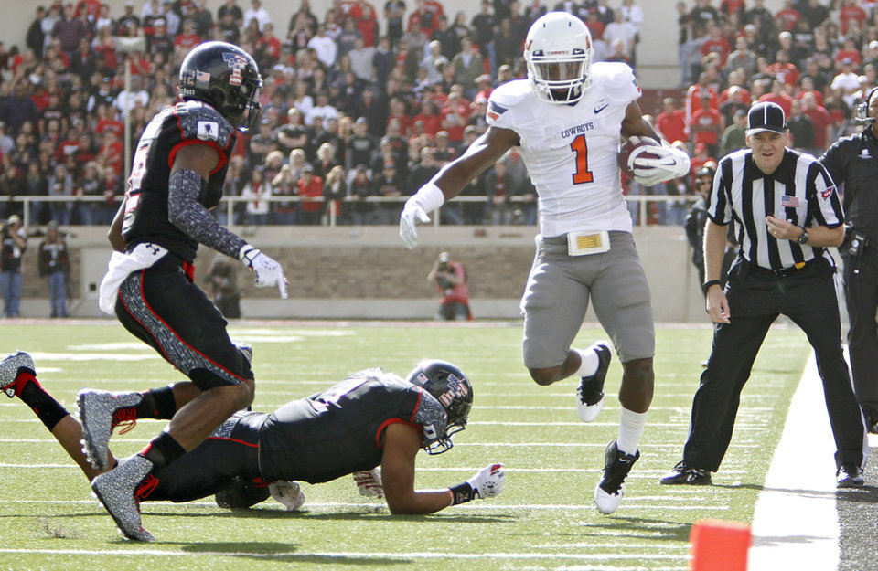 Photo - Oklahoma State Cowboys running back Joseph Randle (1) is run out of bounds by Texas Tech Red Raiders safety Terrance Bullitt (1) and D.J. Johnson (12)during the college football game between the Oklahoma State University Cowboys (OSU) and Texas Tech University Red Raiders (TTU) at Jones AT&T Stadium on Saturday, Nov. 12, 2011. in Lubbock, Texas.  Photo by Chris Landsberger, The Oklahoman