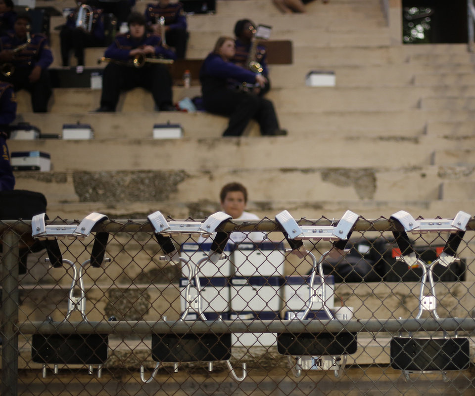 Drum carriers sit on fence at the Northwest Classen vs. Western Heights high school football game at Taft Stadium Thursday, September 20, 2012. Photo by Doug Hoke, The Oklahoman