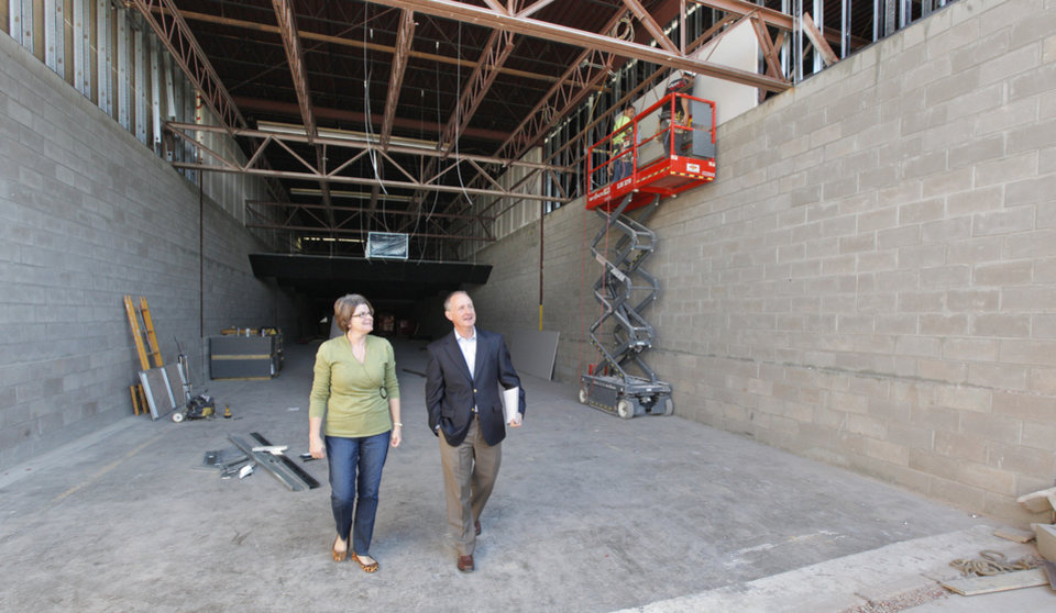 Photo -  Wilshire Gun co-founders Jane Moran, marketing manager, and Jeff Swanson, general manager, walking the 100-yard shooting range under construction at Wilshire Gun in the 600 block of W Wishire Blvd. in Oklahoma City. The shooting ranges will be in a building that once served as a grocers' warehouse. Photo by Paul B. Southerland, The Oklahoman   PAUL B. SOUTHERLAND -  PAUL B. SOUTHERLAND