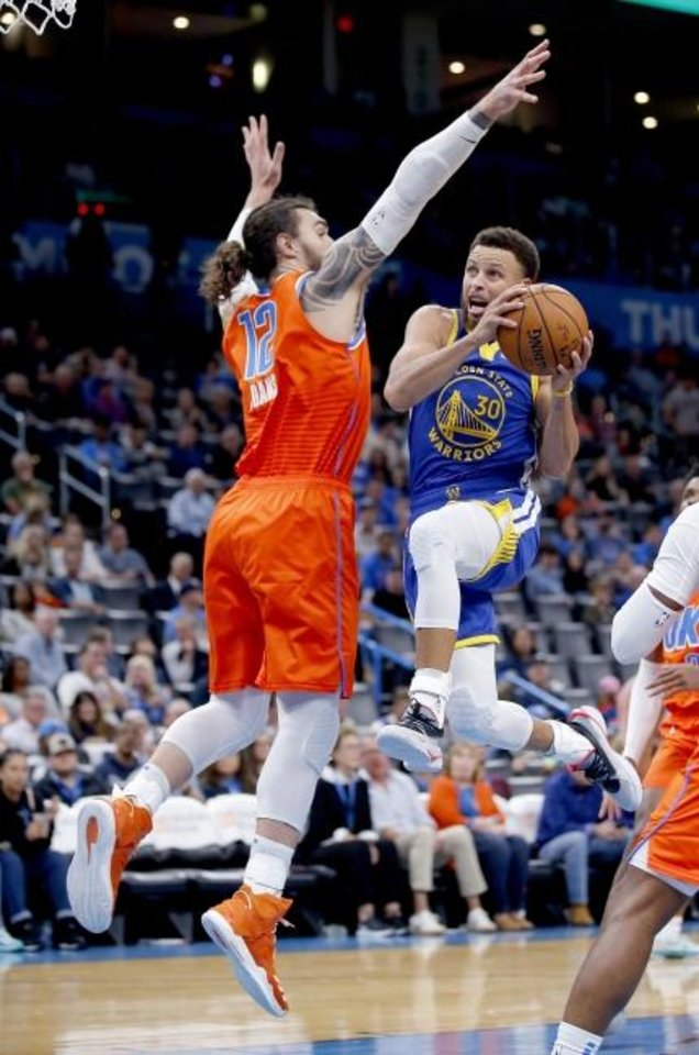 Photo -  Golden State's Stephen Curry, right, goes up for a shot as Oklahoma City's Steven Adams defends during Sunday's game in Chesapeake Energy Arena. OKC won its first game of the season, beating the Warriors, 120-92. [Sarah Phipps/The Oklahoman]