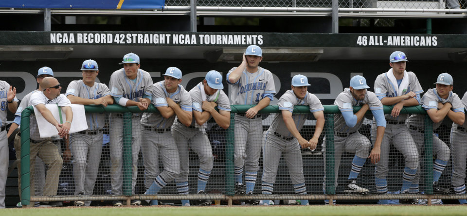 Photo - Columbia players watch the final minutes of an NCAA college baseball tournament regional game against Texas Tech in Coral Gables, Fla., Friday, May 30, 2014. Texas Tech won 3-2. (AP Photo/Alan Diaz)