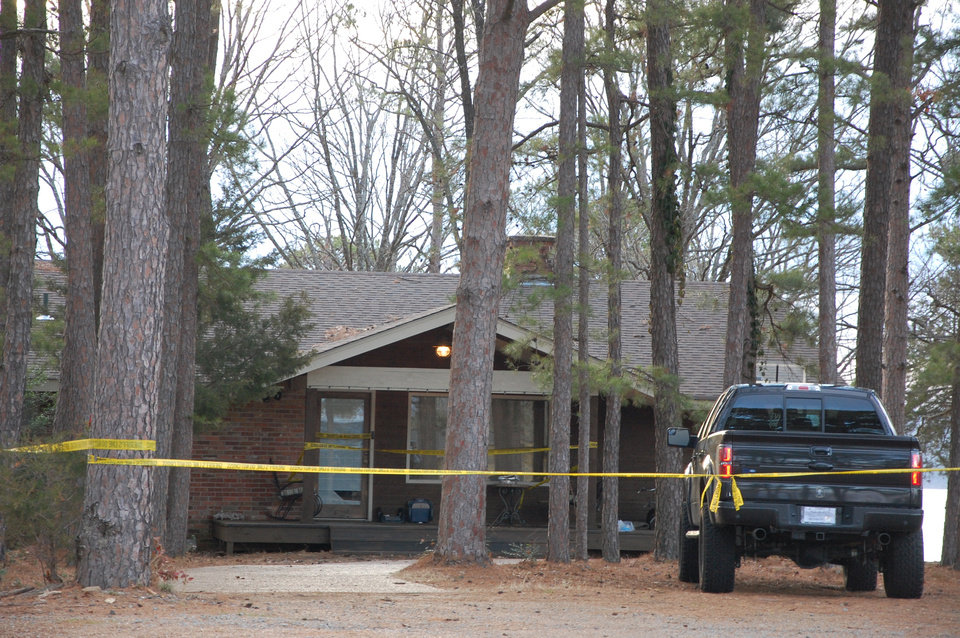Photo - Yellow crime-scene tape blocks off the home of Mindy McCready in Heber Springs, Ark., on Monday, Feb. 18, 2013, the day after the country singer was found dead there Sunday in an apparent suicide. She was 37. (AP Photo/Jeannie Nuss)