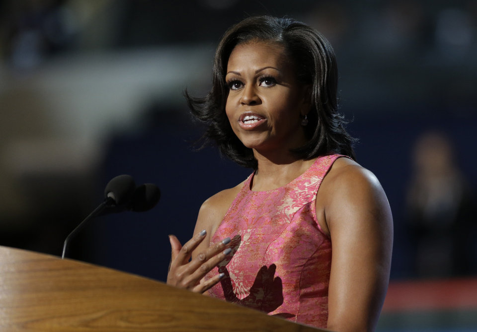 Photo - First Lady Michelle Obama addresses the Democratic National Convention in Charlotte, N.C., on Monday, Sept. 3, 2012. (AP Photo/David Goldman)  ORG XMIT: DNC805