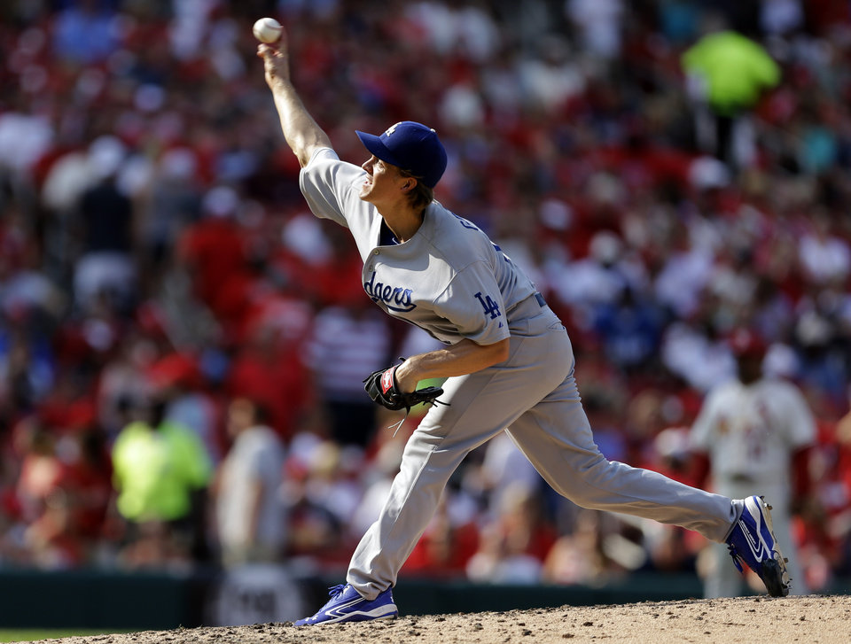 Photo - Los Angeles Dodgers starting pitcher Zack Greinke throws during the sixth inning of a baseball game against the St. Louis Cardinals Saturday, July 19, 2014, in St. Louis. (AP Photo/Jeff Roberson)