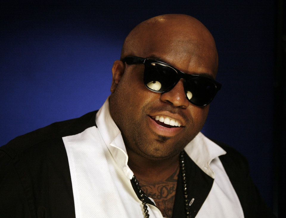 "FILE - Recording artist Cee Lo Green poses for a portrait in this Nov. 16, 2010 file photo taken in New York. Green says he'll stick with ""The Voice"" singing competition show ""as long as it's fresh."" (AP Photo/Jeff Christensen, File)"