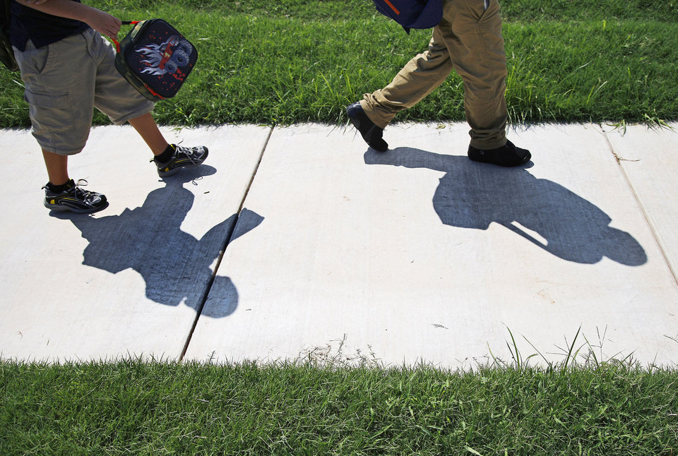 Children leave school on a sidewalk east of Britton Elementary School in Oklahoma City on Wednesday, August 14, 2013. Photo by Bryan Terry, The Oklahoman