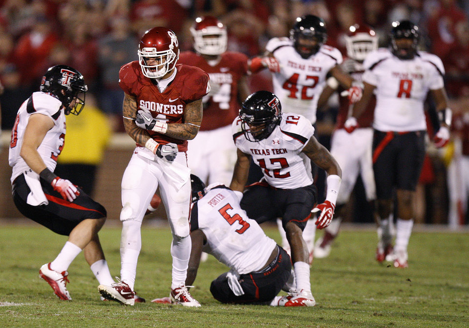 Photo - Oklahoma's Kenny Stills (4) reacts after an interception as Texas Tech celebrates during the college football game between the University of Oklahoma Sooners (OU) and the Texas Tech University Red Raiders (TTU) at Gaylord Family-Oklahoma Memorial Stadium in Norman, Okla., Saturday, Oct. 22, 2011. Photo by Bryan Terry, The Oklahoman