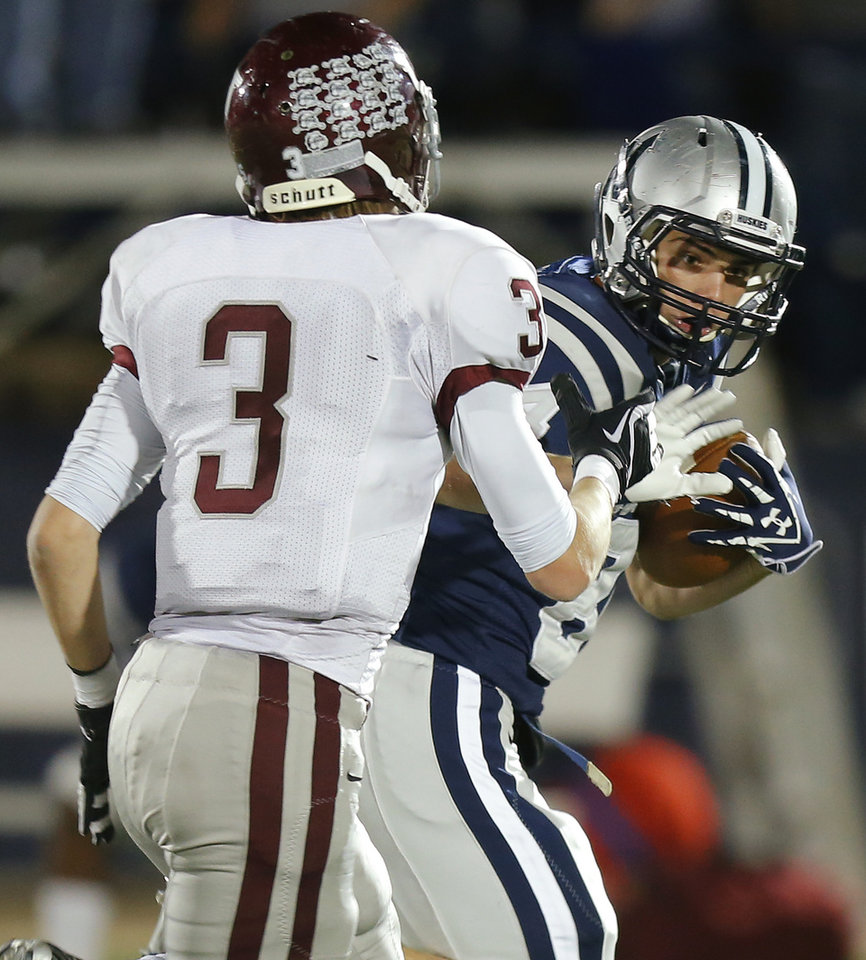 Photo - Edmond North's Jarech Page fights off Edmond Memorial's Sam Kreutzer during a high school football playoff game at Wantland Stadium in Edmond, Okla., Thursday, Nov. 8, 2012. Photo by Bryan Terry, The Oklahoman