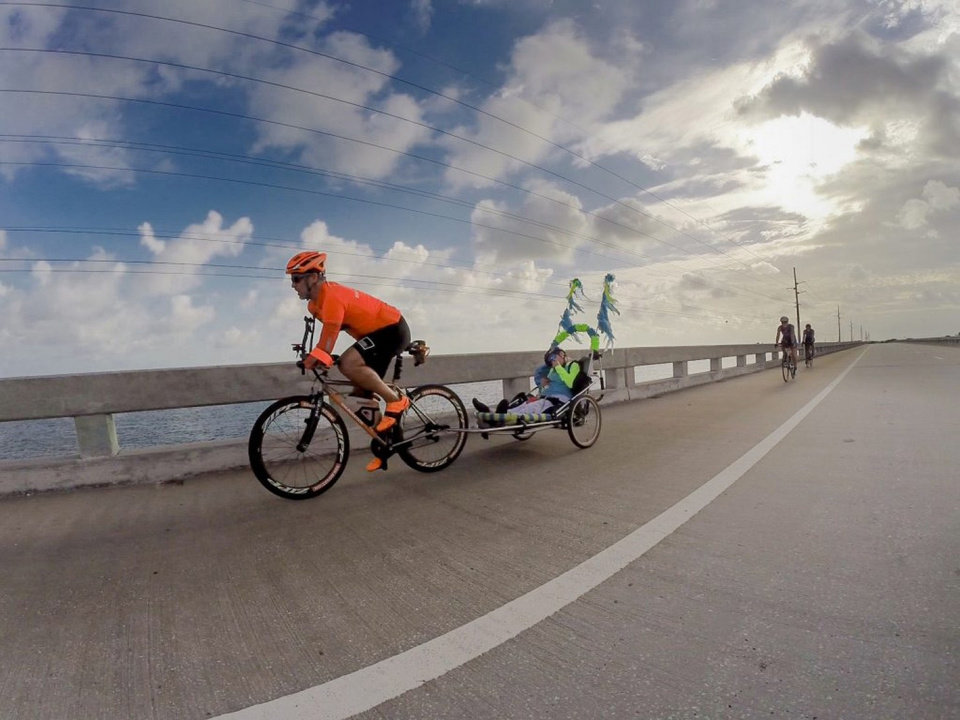 Photo - Double amputee Hector Picard and Kelly Gruson, who is quadriplegic, completed a 50-mile race in the Florida Keys Wednesday. Photo credit: Julio Mendez.