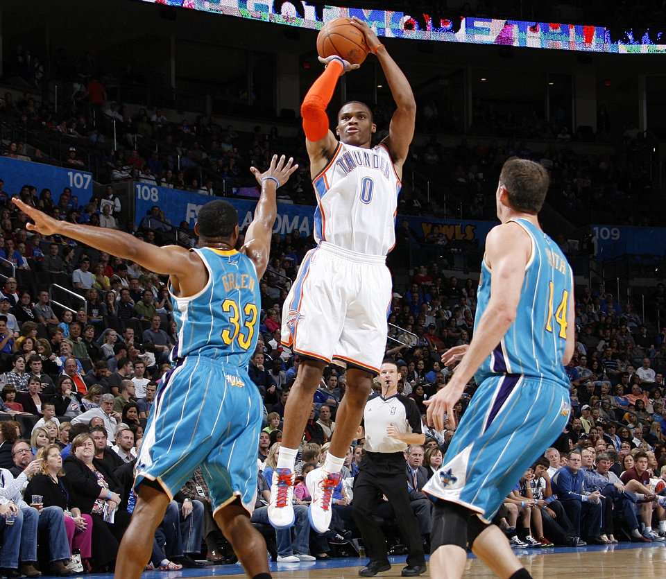 Photo - The Thunder's Russell Westbrook shoots between Willie Green (33) and Jason Smith (14) of New Orleans on Thursday. Photo by Nate Billings, The Oklahoman