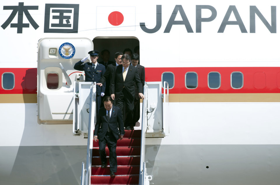 Photo -   Japanese Prime Minister Yoshihiko Noda, bottom, walks down the stairs of his airplane after arriving at Andrews Air Force Base, Md., Sunday, April 29, 2012. President Barack Obama will meet with Noda at the White House, Monday, April 30, 2012. (AP Photo/Cliff Owen)