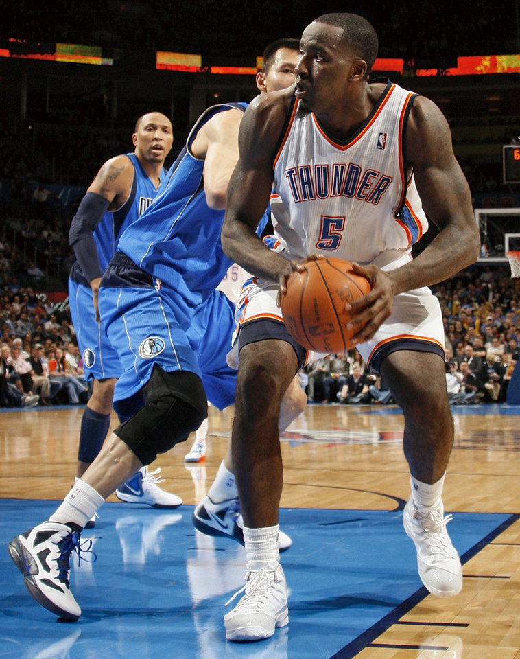 Oklahoma City\'s Kendrick Perkins (5) tries to work around the defense of Dallas\' Yi Jianlian (9) as Shawn Marion (0) looks on during the NBA basketball game between the Oklahoma City Thunder and the Dallas Mavericks at Chesapeake Energy Arena in Oklahoma City, Monday, March 5, 2012. Photo by Nate Billings, The Oklahoman