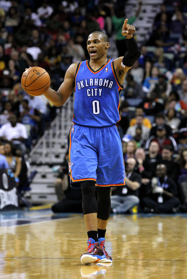 Photo - Oklahoma City Thunder point guard Russell Westbrook (0) calls to his team during the second half of an NBA basketball game against the New Orleans Hornets in New Orleans, Friday, Nov. 16, 2012. The Thunder won 110-95. (AP Photo/Jonathan Bachman) ORG XMIT: LAJB118
