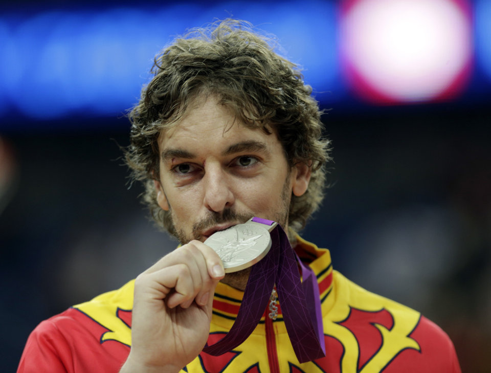 Spain's Pau Gasol kisses his silver medal during the men's gold medal basketball game against USA at the 2012 Summer Olympics, Sunday, Aug. 12, 2012, in London. (AP Photo/Charles Krupa)