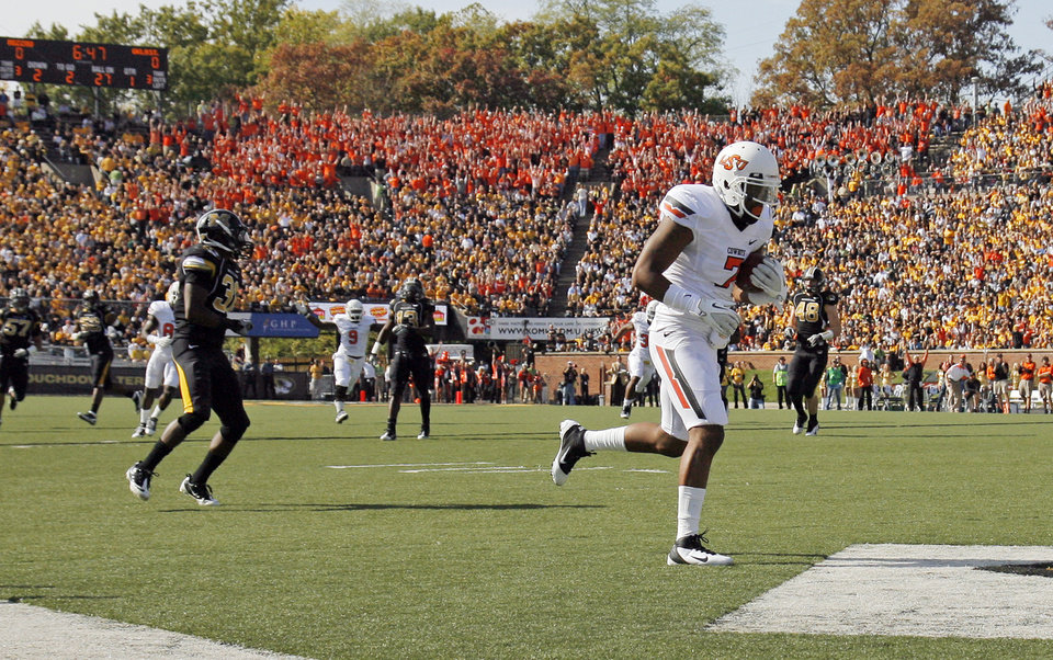 The OSU fans section cheers as Oklahoma State's Michael Harrison (7) scores a touchdown in the first quarter during a college football game between the Oklahoma State University Cowboys (OSU) and the University of Missouri Tigers (Mizzou) at Faurot Field in Columbia, Mo., Saturday, Oct. 22, 2011. Photo by Nate Billings, The Oklahoman