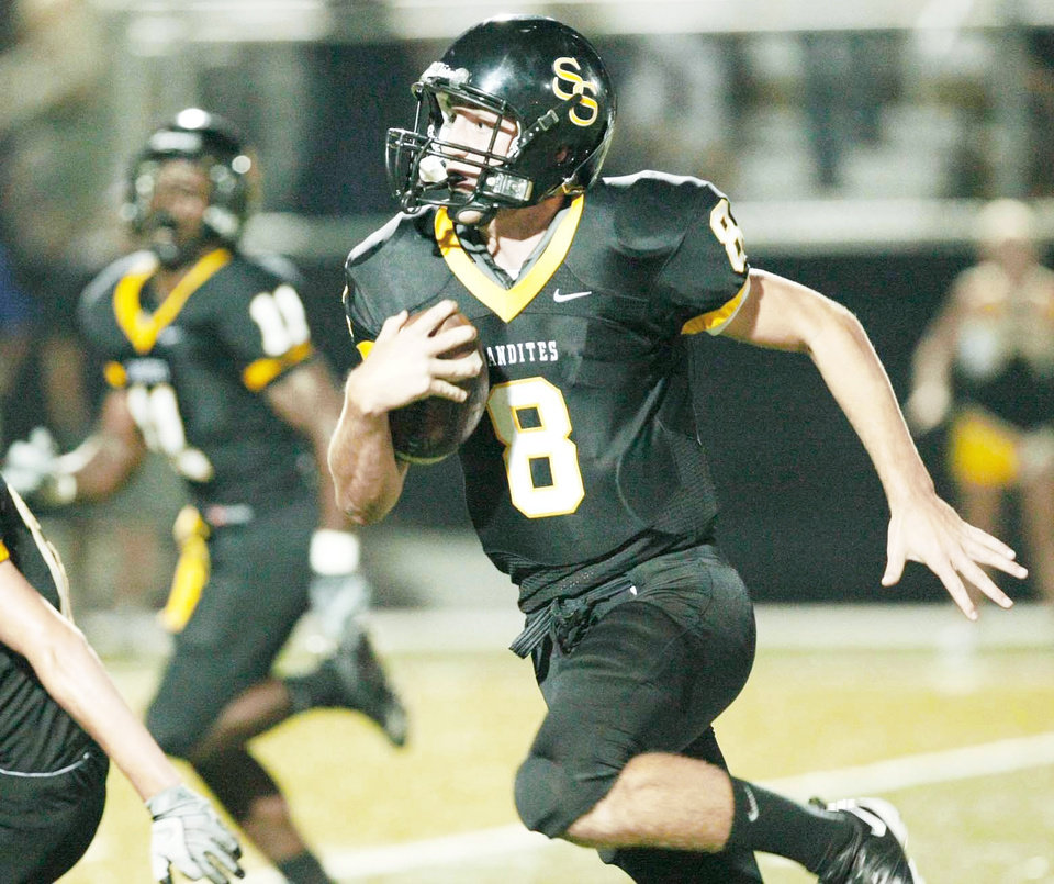 Photo - Sand Springs' quarterback and OSU commit Johnny Deaton is one of several Oklahoma high school players coach Mike Gundy has targeted. Photo by Tom Gilbert, Tulsa World