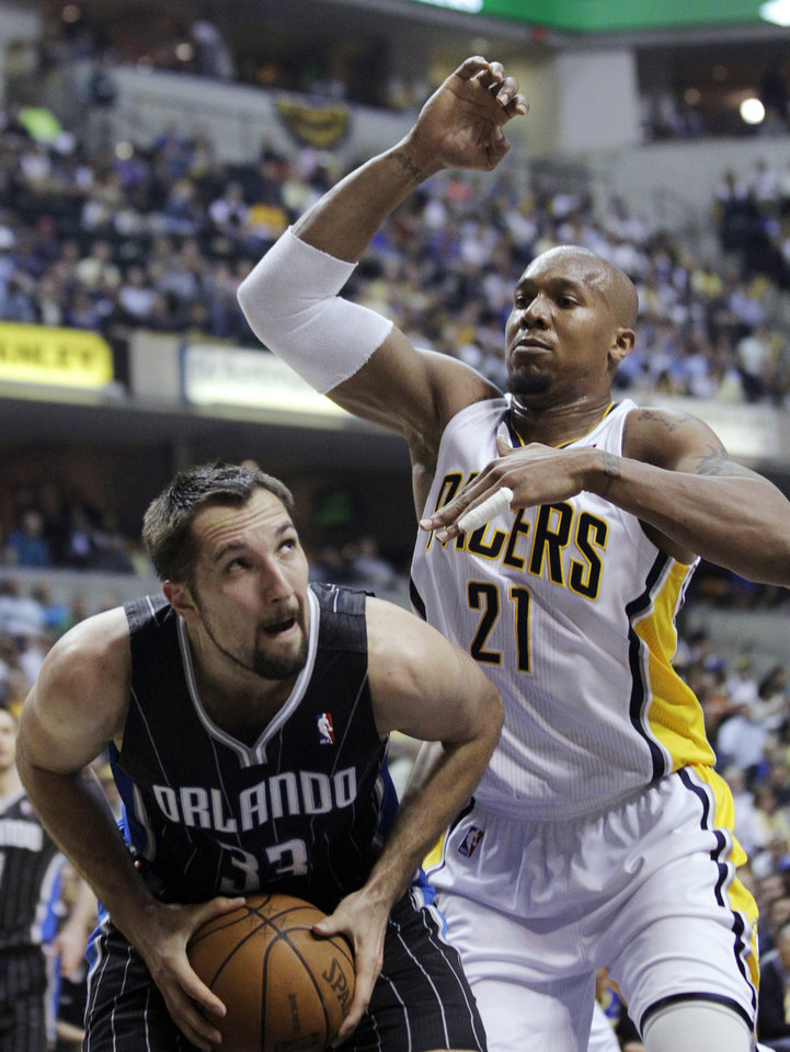 Photo -   Orlando Magic forward Ryan Anderson, left, looks to shoot against Indiana Pacers forward David West during the first half of Game 5 of an NBA basketball first-round playoff series, in Indianapolis on Tuesday, May 8, 2012. (AP Photo/Michael Conroy)