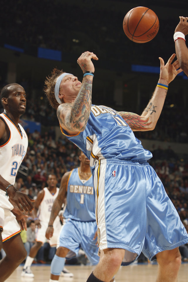 Photo - Chris Andersen tries to catch a loose ball in the first half as the Oklahoma City Thunder play the Denver Nuggets at the Ford Center in Oklahoma City, Okla. on Friday, January 2, 2009.  Photo by Steve Sisney/The Oklahoman