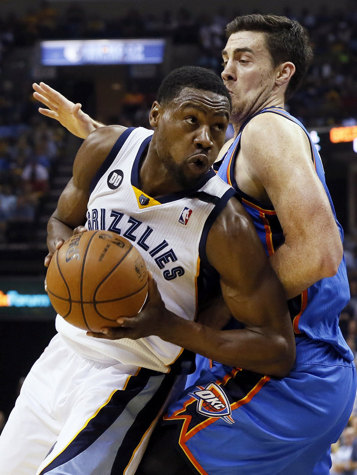 Photo - Memphis' Tony Allen (9) tries to get past Oklahoma City's Nick Collison (4) during Game 3 in the second round of the NBA basketball playoffs between the Oklahoma City Thunder and Memphis Grizzles at the FedExForum in Memphis, Tenn., Saturday, May 11, 2013. Memphis won, 87-81. Photo by Nate Billings, The Oklahoman