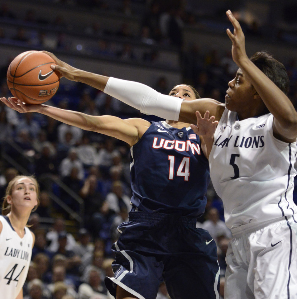 Photo - Penn State's Talia East (5) blocks a shot by Connecticut's Bria Hartley (14) in the first half of an NCAA college basketball game, Sunday, Nov. 17, 2013, in State College, Pa. (AP Photo/John Beale)