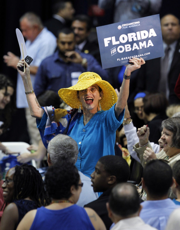 Elizabeth Garcia, center, of Miami cheers as the crowd waits to hear former President Bill Clinton speak at Florida International University, Tuesday, Sept. 11, 2012, in Miami, as Clinton campaigns for President Barack Obama. (AP Photo/Wilfredo Lee)
