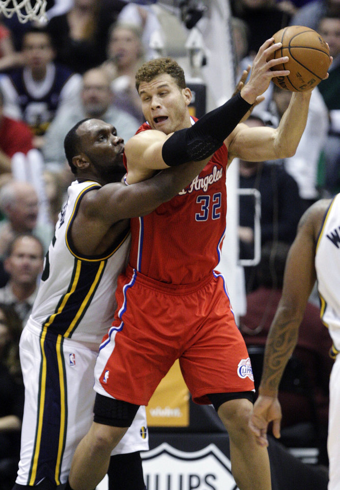 Utah Jazz center Al Jefferson (25) defends against Los Angeles Clippers forward Blake Griffin (32) in the third quarter of an NBA basketball game, Monday, Dec. 3, 2012, in Salt Lake City. (AP Photo/Rick Bowmer)