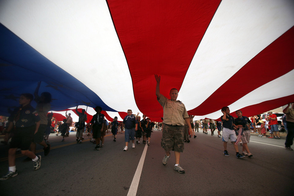 Boy Scouts of America and Cub Scout troops carry a large American flag during the LibertyFest Parade in Edmond, Okla., Monday, July 4, 2011. Photo by Sarah Phipps, The Oklahoman