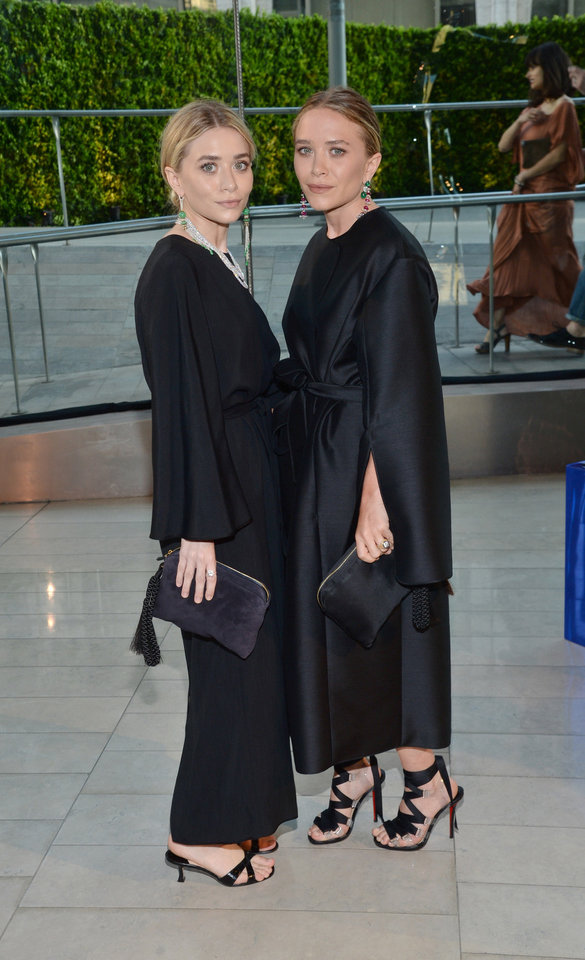 Photo - Mary-Kate Olsen and Ashley Olsen arrive at the 2014 CFDA Fashion Awards held at Alice Tully Hall, Lincoln Center, on Monday, June 2, 2014, in New York. (Photo by Evan Agostini/Invision/AP)