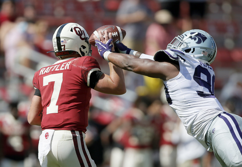 Photo - Oklahoma's Spencer Rattler (7) is hit by Kansas State's Bronson Massie (90) as he throws during a college football game between the University of Oklahoma Sooners (OU) and the Kansas State Wildcats at Gaylord Family-Oklahoma Memorial Stadium, Okla., Saturday, Sept. 26, 2020. Kansas State won 38-35. [Bryan Terry/The Oklahoman]