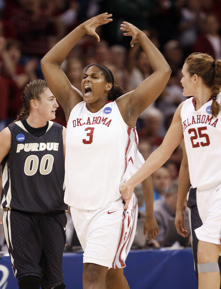 Photo - Courtney Paris encourages the crowd to yell in the second half as the University of Oklahoma (OU) plays Purdue in the NCAA women's basketball regional tournament finals at the Ford Center in Oklahoma City, Okla., on Tuesday, March 31, 2009. .   Photo by Steve Sisney, The Oklahoman