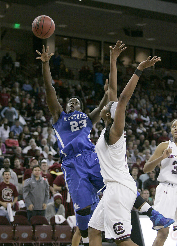 Photo - Kentucky's Samarie Walker (23) drives for the basket as South Carolina's Alaina Coates (41) tries to block during the second half of their NCAA college basketball game, Thursday, Jan. 9, 2014, in Columbia, SC South Carolina defeated Kentucky 68-59. (AP Photo/Mary Ann Chastain)
